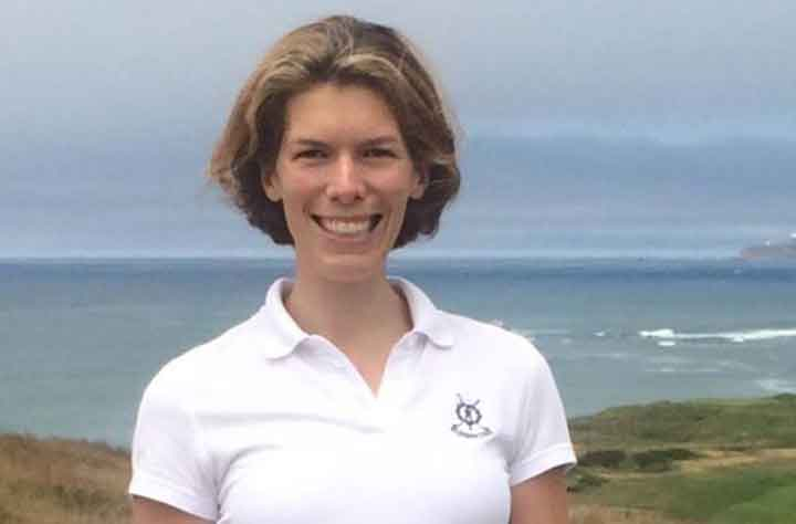 Alumnae ANNE-KATHRIN WITT '07 stands in front of ocean.
