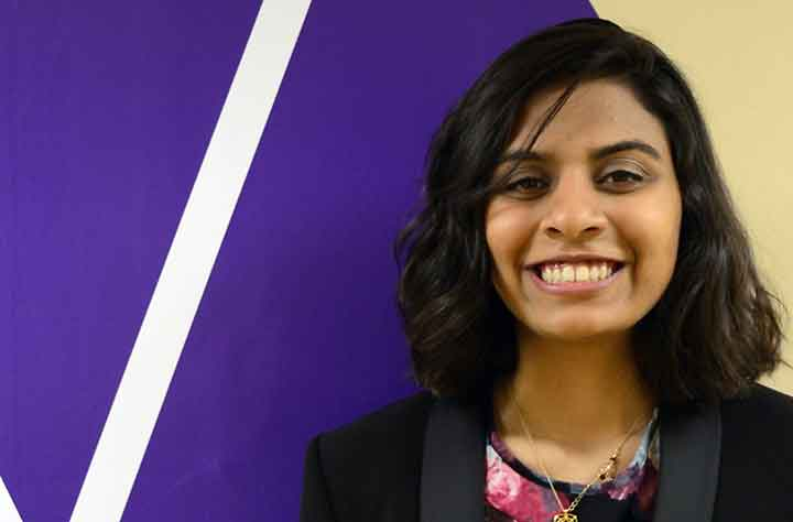 Current Wesleyan Student FATIMA KHAN smiles for the camera in the hallway of OSP