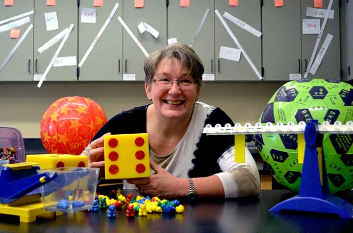 Virginia B. Wilcox surrounded by educational toys she uses to help teaching in the classroom
