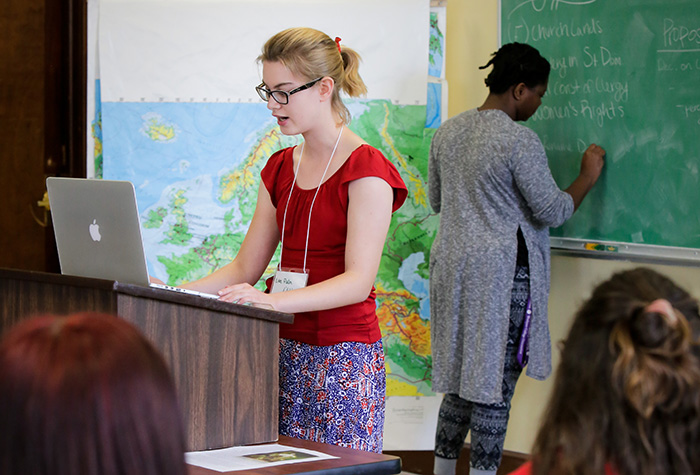 History student presents work to classroom