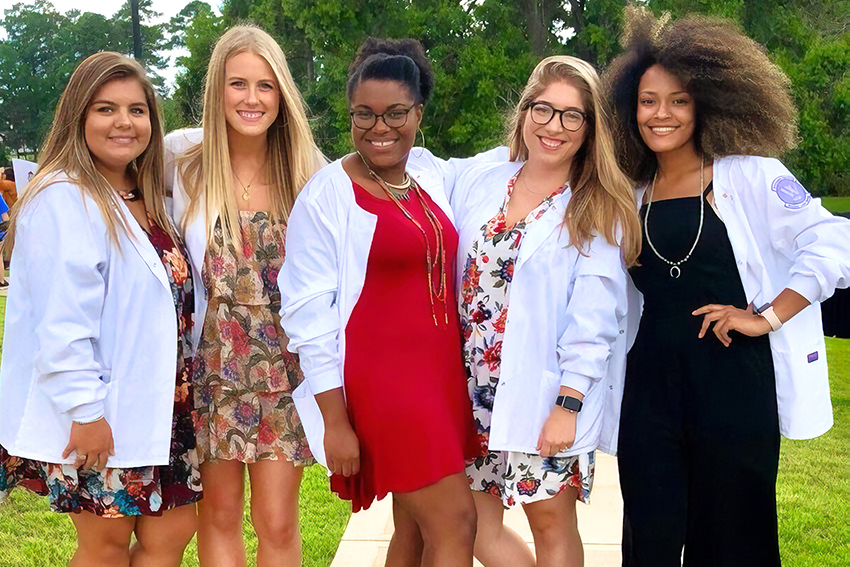 Wesleyan Nursing students stand outside after White Coat Ceremony.