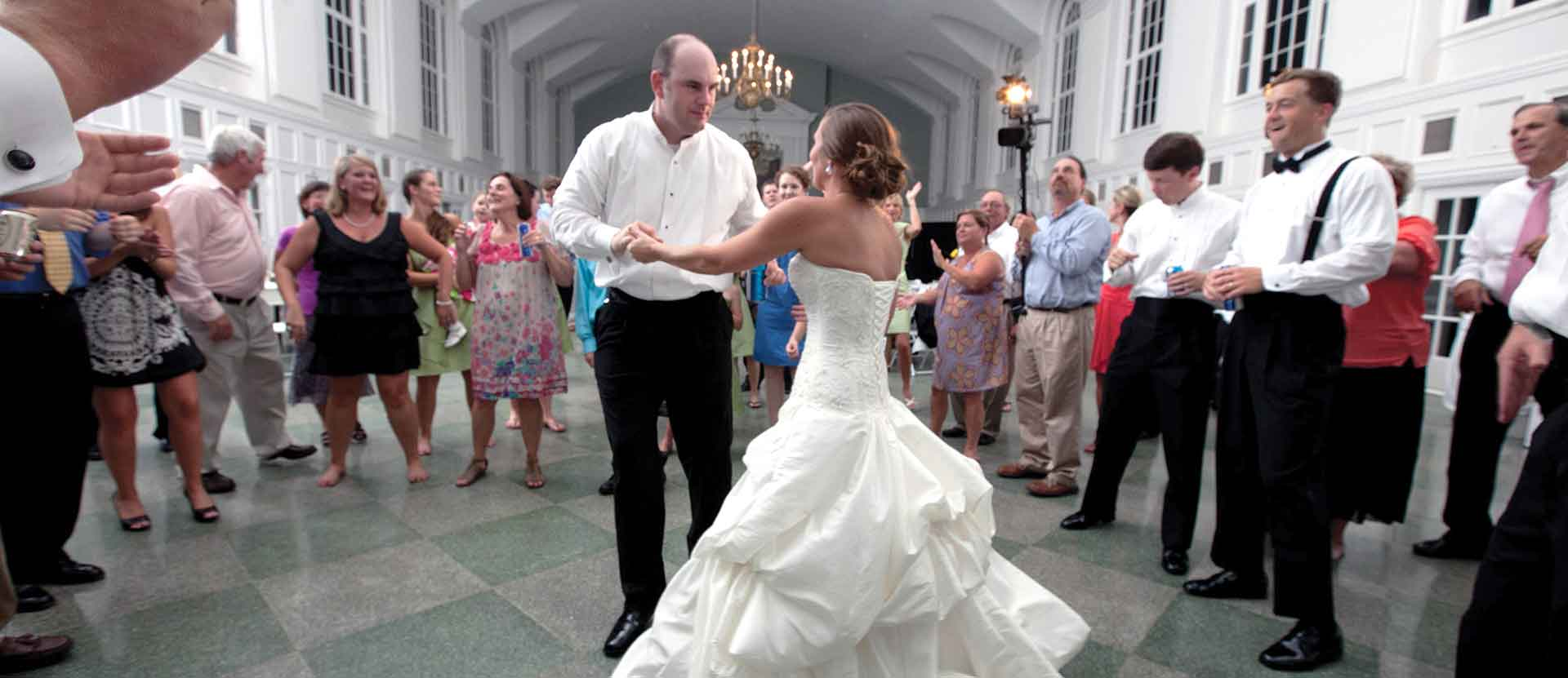 Groom and Bride dancing in the Dining Hall Reception.